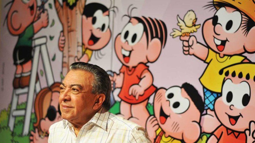 Maurício de Souza e seus personagens em evento.